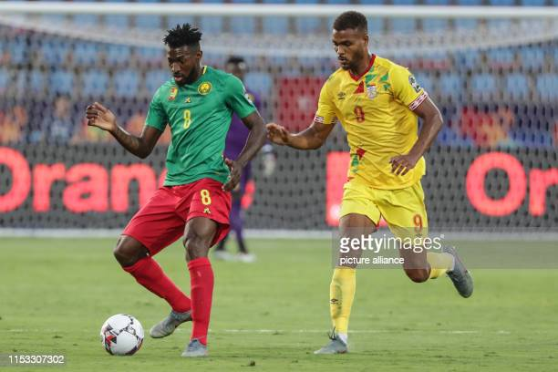 July 2019, Egypt, Ismailia: Benin's Steve Mounie and Cameroon's Andre Zambo Anguisaa battle for the ball during the 2019 Africa Cup of Nations Group...
