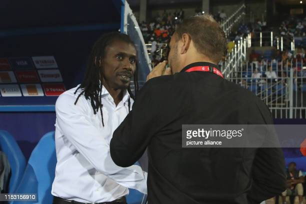 Soccer Africa Cup Kenya Senegal Preliminary round Group C Matchday 3 Senegal's manager Aliou Cisse welcomes Sebastien Migne before the start of the...