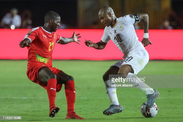 Ghana's Andre Ayew and GuineaBissau's nanu battle for the ball during the 2019 Africa Cup of Nations Group F soccer match between GuineaBissau and...
