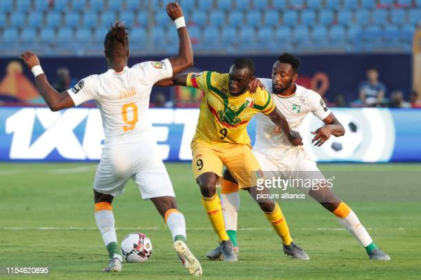 Mali's Moussa Marega and Cote d'Ivoire's Wilfried Kanon Wilfried Zaha battle for the ball the 2019 Africa Cup of Nations round of 16 soccer match...