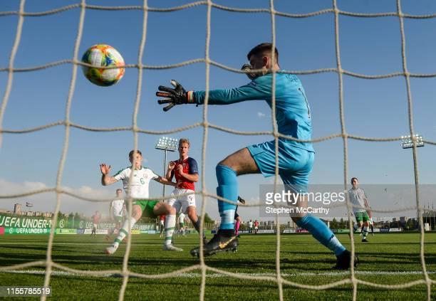 July 2019 Erik Botheim of Norway shoots to score his side's first goal past Republic of Ireland goalkeeper /b1 during the 2019 UEFA European U19...