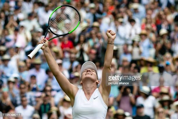 July 2019, Great Britain, London: Tennis: Grand Slam, Wimbledon, women, singles, semi-final: Halep - Svitolina . Simona Halep cheers after her final...