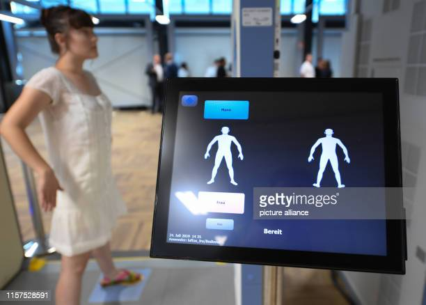 A woman is standing in a body scanner in a newly constructed hall in Terminal 1 of Frankfurt Airport The seven new control lanes are intended to...