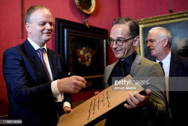 Eike Dieter Schmidt Director of the Uffizi and Maurizio Catolfi Head of Department present Heiko Maas Foreign Minister with a framed photo of the...