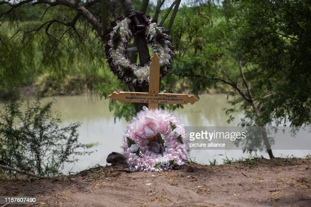Souvenir of little Angie Valeria and her father Oscar Alberto 23 June 2019 stands on the cross on the banks of the Rio Grande where almost twoyearold...