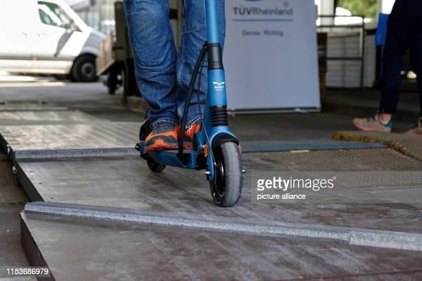 04 July 2019 North RhineWestphalia Cologne Tester Jens Peuker drives over a test track at a TÜV Rheinland press conference on the safe handling of...