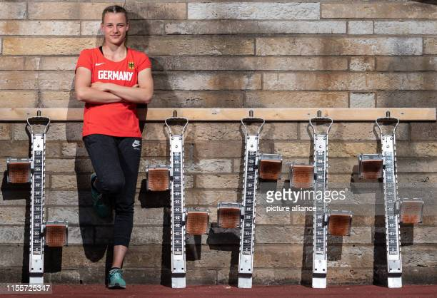 Sprinter Chiara Schimpf stands in the Heinz Steyer Stadium between starting blocks hanging on the wall Photo Robert Michael/dpaZentralbild/dpa