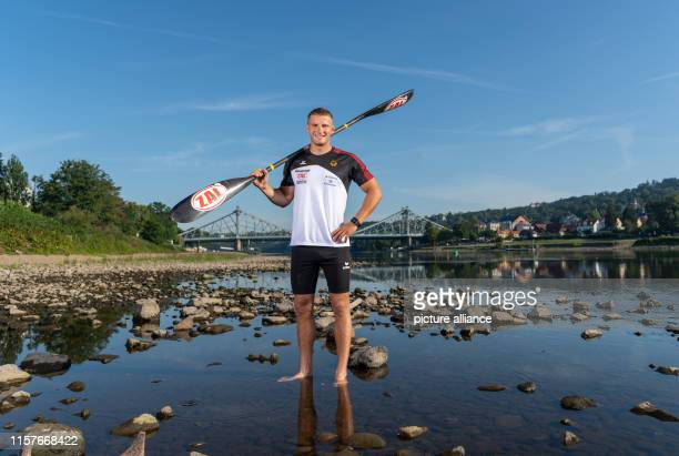 Tom Liebscher Olympic Canoe Champion is standing in front of the Blue Wonder Bridge after a training session for the World Championships in the Elbe...