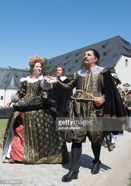 July 2019, Saxony, Königstein: Amateur actors wear Renaissance costumes on the occasion of the Renaissance festival on the Königstein fortress. The...