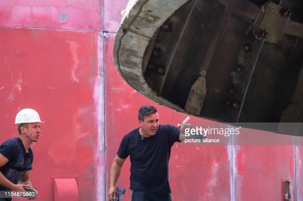 10 July 2019 SaxonyAnhalt Benneckenstein Mario Tänzer from the Ostdeutscher Fahrzeug und Technikmuseum sprays glue on the roof of a former radar dome...