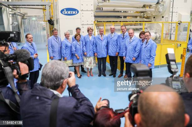 The Belgian royal couple King Philippe and Queen Mathilde stand in a group picture in a production line for polyamide 6 films of the chemical company...