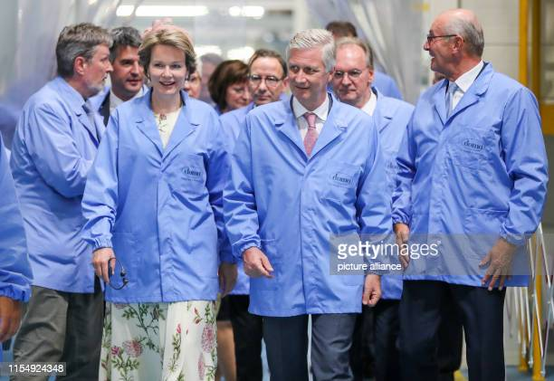 The Belgian royal couple King Philippe and Queen Mathilde visit a production line for polyamide 6 films of the chemical company Domo in the Leuna...