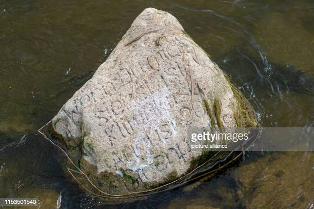 A stone with the inscription If you see me it's a climate crisis August 2018 Greenpeace lies in the shallow water of the Elbe The stone was laid...