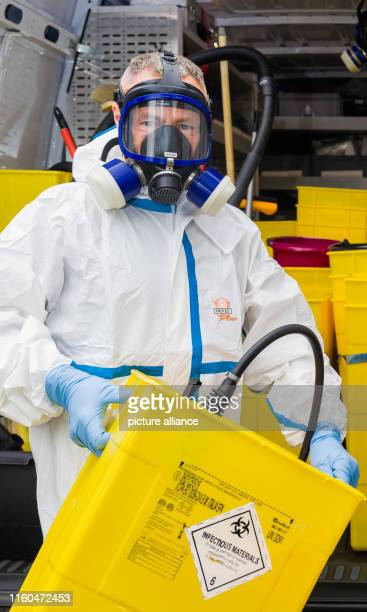 05 July 2019 SchleswigHolstein Walksfelde Crime scene cleaner Dirk Plähn takes a special container to transport toxic organic material from his...