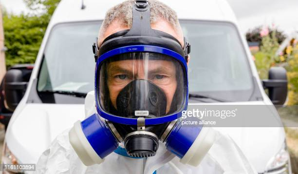 05 July 2019 SchleswigHolstein Walksfelde Crime scene cleaner Dirk Plähn stands in protective suit and with breathing mask in front of his emergency...