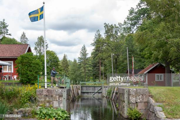 A lock value opens a lock gate on the Dalsland Canal Photo Stephan Schulz/dpaZentralbild/ZB