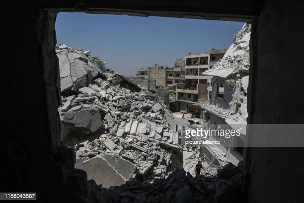 A general view on a collapsed building following a reported air strike by proregime forces in the town of Ariha near Idlib Photo Anas Alkharboutli/dpa
