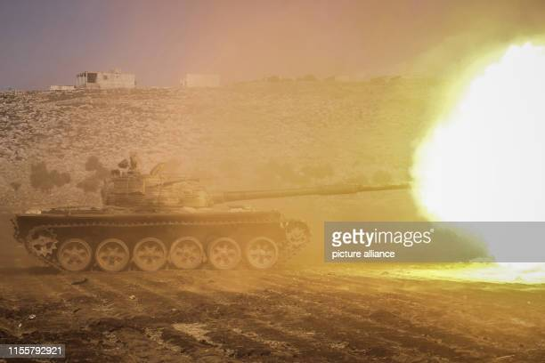 Apicture shows a tank firing during a military show of Jaysh alIzza formation of the Syrian armed opposition during the graduation from a special...