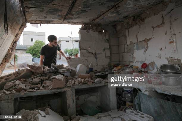 A man inspects the rubble of a building that was destroyed in an airstrike allegedly carried out the day before by the Syrian government on the town...