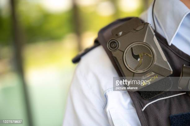 July 2020, Baden-Wuerttemberg, Stuttgart: A police officer is wearing a body cam. Photo: Sebastian Gollnow/dpa