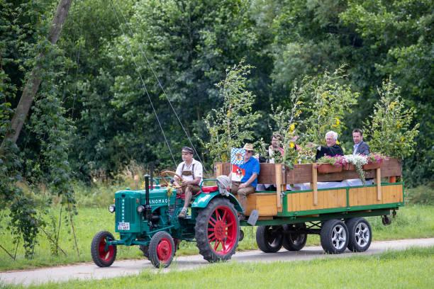 DEU: Protestant Bishop Of Bavaria Uses Tractor Trailers For Parish Fair Celebrations