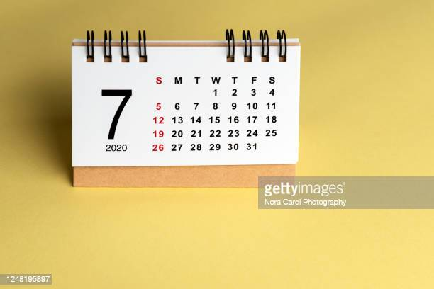 july 2020 calendar on yellow background - july stock pictures, royalty-free photos & images
