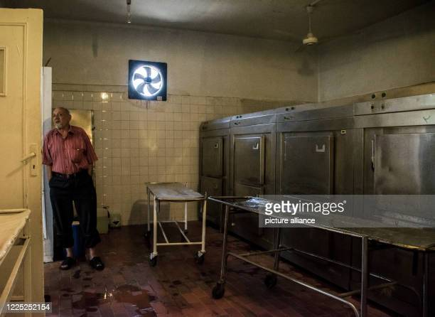 A man stand inside the morgue of the 6th of October Central Hospital which is currently serving as an isolation hospital for Coronavirus patients...