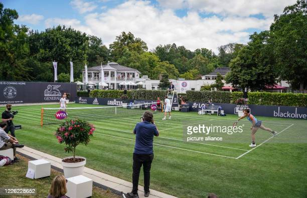 July 2020, Hessen, Bad Homburg: In a show-mixed for the opening of the Bad Homburg Center Court, young player Mara Guth , Davis Cup team boss Michael...
