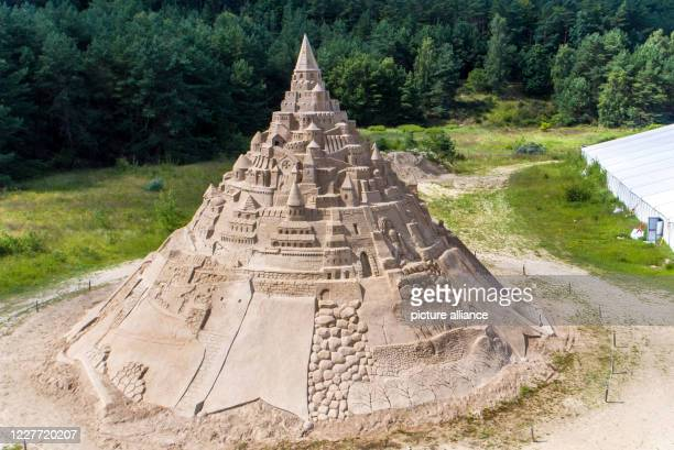 July 2020, Mecklenburg-Western Pomerania, Binz: The highest sand castle in the world stands at the Sand Sculpture Festival on the Baltic Sea island...