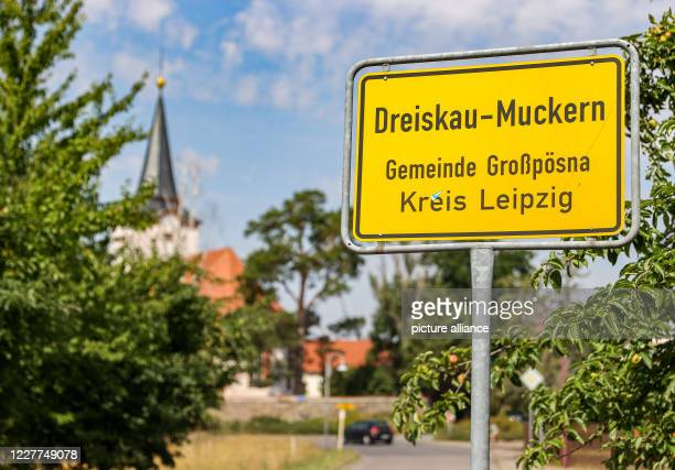 July 2020, Saxony, Dreiskau-Muckern: The place-name sign of the village, which in GDR times was still intended for excavation. In 1996 the people...