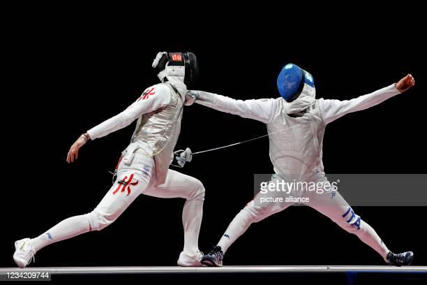 July 2021, Japan, Chiba: Fencing: Olympics, foil singles, men's final, at Makuhari Messe Hall B. Cheung Ka Long of Hong Kong and Daniele Garozzo of...