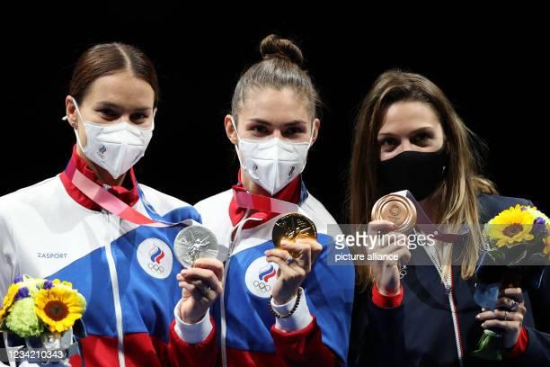 July 2021, Japan, Chiba: Fencing: Olympics, sabre, individual, women, final at Makuhari Messe Hall B. Sofia Velikaya of the Russian Olymp. Committee...