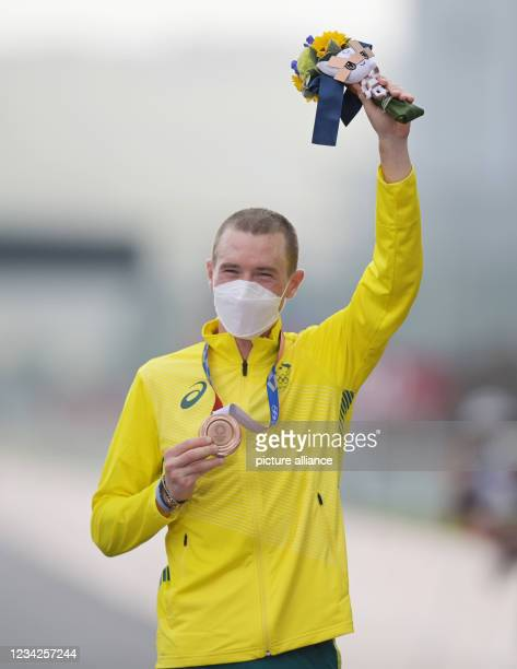 July 2021, Japan, Oyama: Cycling: Olympics, Oyama , men's individual time trial at Fuji International Speedway. Rohan Dennis from Australia cheers at...