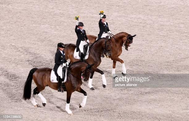 July 2021, Japan, Tokio: Equestrian sport/dressage: Olympics, Team, Final, Equestrian Park. Dorothee Schneider , Isabell Werth and Jessica von...
