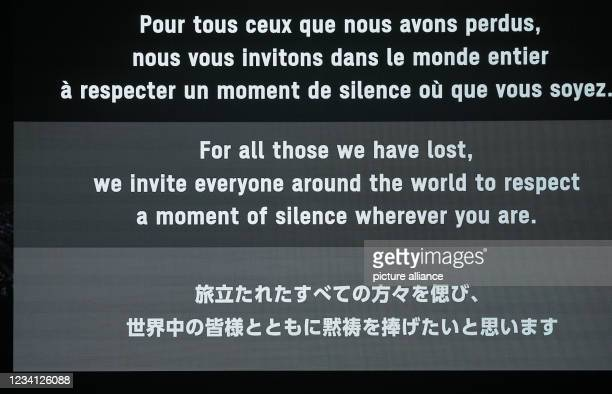 July 2021, Japan, Tokio: Olympia: Opening ceremony in the Olympic Stadium. On a large video screen there is a notice for a minute's silence. Photo:...
