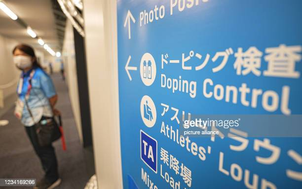 July 2021, Japan, Tokio: Swimming: Olympics, at the Tokyo Aquatics Centre. A sign points to the doping control station. Photo: Michael Kappeler/dpa