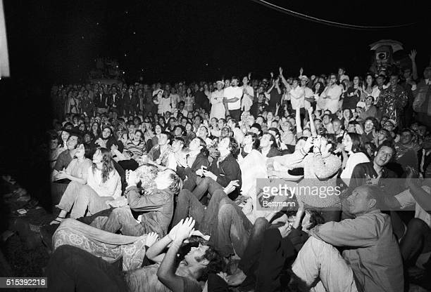 July 21 1969New York New York Rainsoaked New Yorkers watch TV and cheer as they see Apollo 11 astronaut Neil Armstrong's first step on the lunar...