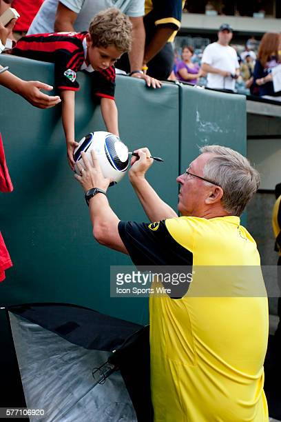 Manchester United head coach Sir Alex Ferguson signing autographs prior to the international friendly match between Manchester United and the...