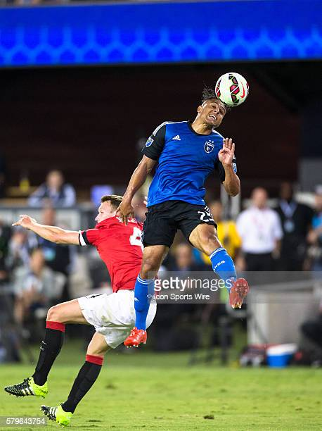 San Jose Earthquakes forward Quincy Amarikwa jumps over Manchester United defender Phil Jones to head the ball during the International Champions Cup...