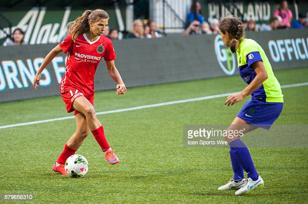 Tobin Heath of Portland Thorns attempts to dribble past Stephanie Cox of Seattle Reign Providence Park Portland OR