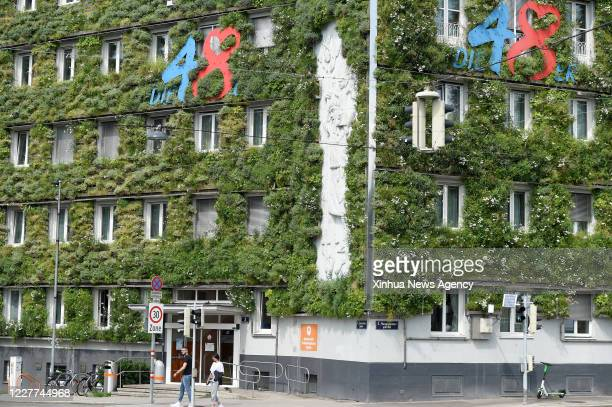 July 22, 2020-- Photo taken on July 22, 2020 shows green facades of the MA 48 headquarters in Vienna, Austria. The facades of the MA 48 headquarters...