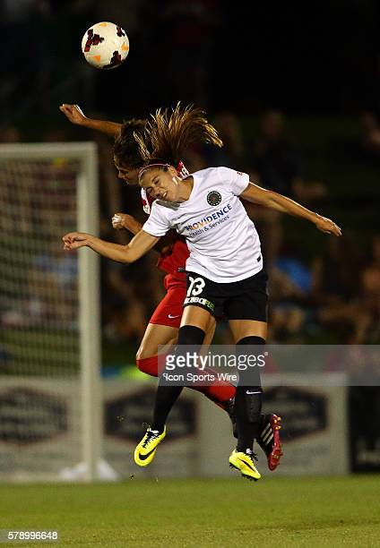 Alex Singer of the Washington Spirit goes for a header against Alex Morgan of the Portland Thorns during a NWSL match at the Maryland Soccerplex in...