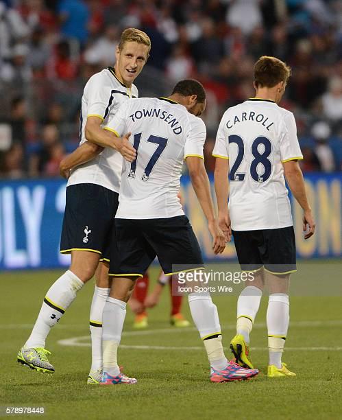 Tottenham Hotspur defender Michael Dawson congratulates forward Andros Townsend along with midfielder Tom Carroll after Townsend scored the winning...