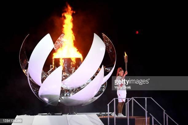 July 23, 2021: Tennis great Naomi Osaka lights the calderon during opening ceremonies at the 2020 Tokyo Olympics.