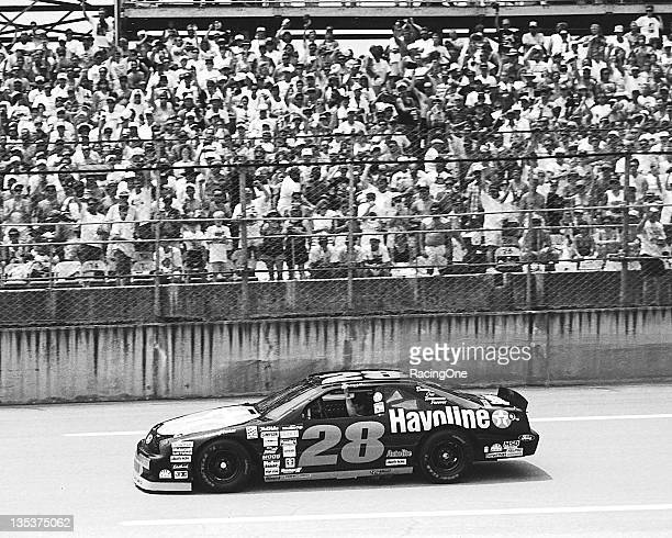 Donnie Allison drives a memorial lap before the DieHard 500 NASCAR Cup race at Talladega Superspeedway in honor of his nephew Davey Allison who lost...