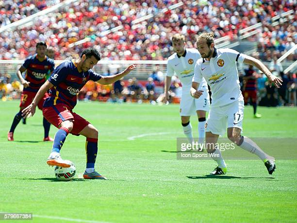 Barcelona forward Pedro challenges Manchester United midfielder Daley Blind during the International Champions Cup match between Manchester United...