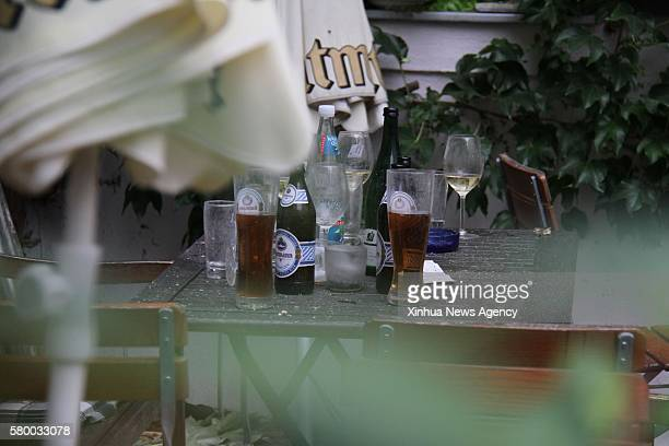 ANSBACH July 25 2016 Drinks are left on the table of a restaurant near the explosion site in Ansbach Germany July 25 2016 The explosion that left one...