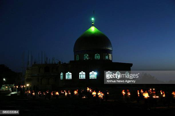 HERAT July 25 2016 People attend a candlelight vigil to commemorate victims of Kabul twin bomb attack in Herat province Afghanistan July 24 2016 In...