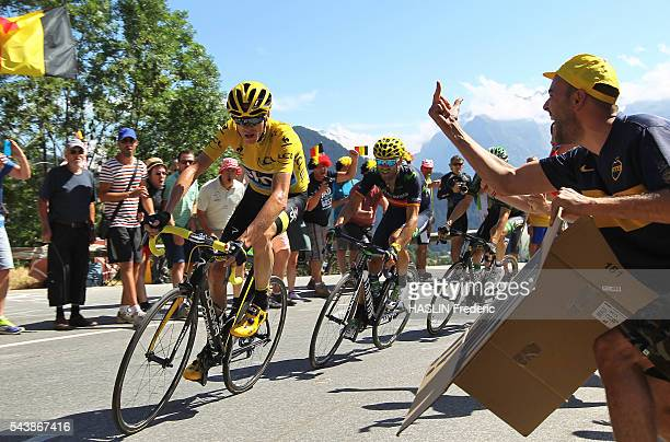 2015 july 25th Tour de France 20th stage étape Modane Alpe d'Huez Montée de l'Alpe d'Huez climb virage n°4 Christopher Froome with a spectator who...