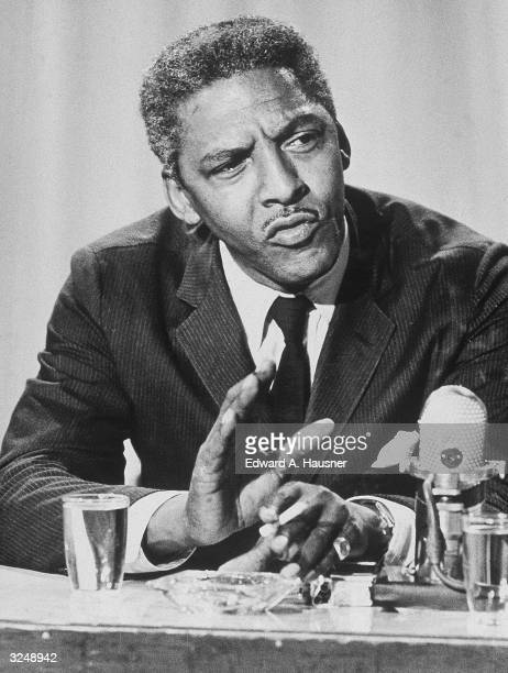 American civil rights activist Bayard Rustin executive director of the Philip Randolph Institute appears on a television program to discuss racial...